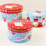 Colorful round hat gift paper box with rope handle