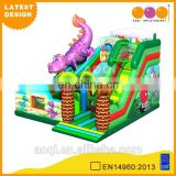 2015 AOQI latest design dino cheap outdoor inflatable amusement park for sale