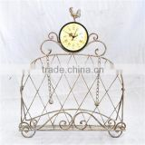 Distressed wrought iron used magazine racks with clock
