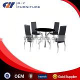 Dining Table in Round Black Glass With 4 Chairs