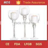 Cone shaped clear glass long stem candle holder cross                                                                         Quality Choice