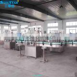 Automatic linear type oil bottling filling packing machine for olive cooking sunflower oil in bottle barrel or jar can