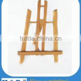 Professional artist painting wood easel