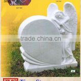 White marble tombstone and standing angel monument design