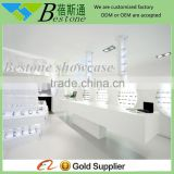 retail optical shop interior design for decorative wall wooden shelf
