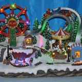 Musical lighted fairground with moving carousel,ferries wheel,skating three movement, 8 songs music