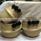 High quality best selling eco-friendly Natural seagrass baskets with black pompoms from Vietnam