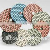 Dry polishing pads with QRS