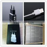 OEM black white gold logo printing us eu 1.5a dual usb universal power bank charger with micro cable and paper box