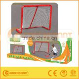 The big Hockey Goal with hockey stick and ball for children playing outdoor with ball and sticks