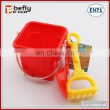 Red plastic mini sand bucket with shovel