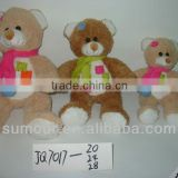 plush brown toy teddy bear with a ribbon