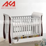 OEM Modern White Lacquer MDF Baby Cot Bed With Wheels