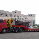 16 tons steyr tractor head mounted crane(with low bed semi trailer)contact Mr. Tom song king 24 hours phone:TEL:0086-15271357675