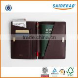 Dongguan factory direct custom passport holder with button closed,Multi-fuction leather passport cover with pen