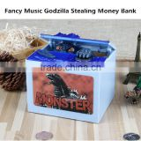 Latest Arrival Music Fancy Godzilla Stealing Money Piggy Bank, Electric Decorative Novelty Monster Coin Bank For Kids