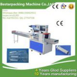 disposable syringe flow pack /disposable syringe packaging machine/disposable syringe packing machine/ disposable syringe wrapping machine/ disposable syringe sealing machine