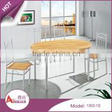 Dining room simple design cheap long 130cm oval wood pvc vintage dining table with 4 chairs