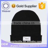 Fashion Cuff 100% Acrylic Black Knitted Beanie Hat with Woven Label for Wholesale