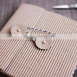 ribbed and textured kraft paper envelopes with string tie for gift packaging