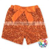 Wholesale boutique kids girl clothes orange sequin cotton ribbon bow sequin shorts baby summer shorts