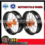 "Motorcycle wheels:KTM Supermoto wheelsets: orange hubs with black rims 3.50-17"" and 5.00-17"""