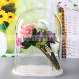 Glass dome for flower with white wooden base