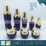 Purple colored cosmetics glass serum dropper bottle and skin face cream jar with silver cap