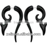 A fake spiral ear rings stretchers in black acrylic body jewelry