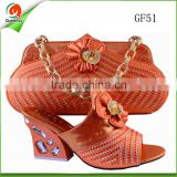 orange leather handbags and women's high heel shoes to match for wedding