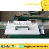 Manual notebook type beeswax foundation sheet embossing machine with size customized