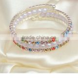 Three rows crystal and rhinestone graduated wraparound coil bracelet