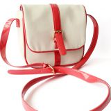 white canvas messenger bag with long leather shoulder