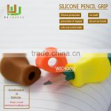 Wholesale silicone pencil grip between index and middle finger aimed at correcting children hold a pen comfortable ly