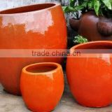 Set of 3 Orange ceramic pots,