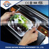 Efficient pvc cling film packing machine food tray film sealing machine