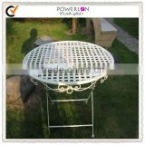 Antique white hammered metal table