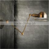Vintage Adjustable Brass Wall Sconce with Cone with an extendable arm can be adjusted into different positions
