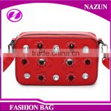 2016 wholesale cheap new trendy mini red PU leather shoulder bags with rhinestones flowers and rivets studded