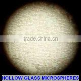 Weight reduction white hollow glass spheres for oil cementing slurry
