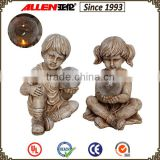 Exquisite working presents 7.9*9.1*12 holding solar light ball boy and girl statue resin decor