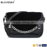 Classic style metal snap fur flap with decorative chain design black leather crossbody bag