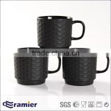 Ceramic stoneware stackable embossed black white coffee mug with dots