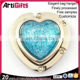 Handmade foldable heart shape table top bag hanger