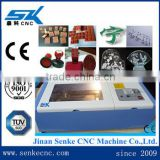 Fashion cotton fabric laser cutting textile machine leather craft /1400*1000mm knitted woven jeans laser cutting machine