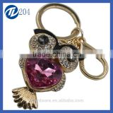 Novelties goods from china crystal floating charms purse bag hello owl keyring for couples