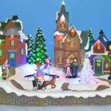 Polyresin Christmas Decoration 12''Led village scene with moving skating and crystal tree, eight songs music