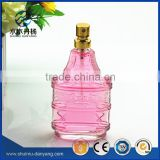 Unique shaped perfume glass bottle 50ml with golden spray                                                                                                         Supplier's Choice