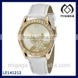 Gold Tone Crystal Accented Leather Womens Watch 14K light gold flower dial crystal setting white band cheap alloy watch