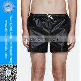 Hot selling black no pockets waterproof swimming trunks for men